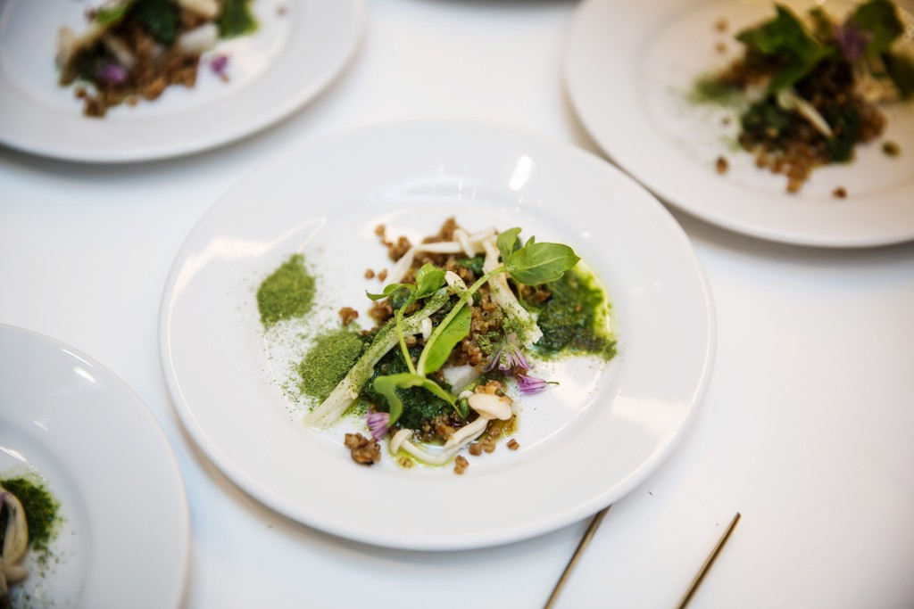 In teams of two, the chefs created futuristic dishes featuring unusual plants with wonderful names like scotch bonnet. Pictured here is Chef's Lerato Sitole and David Johansson's dish, highlighting enoki mushrooms, ancient maize flour and Skånska gryn (a locally sourced medley of oats, rye, wheat and barley).