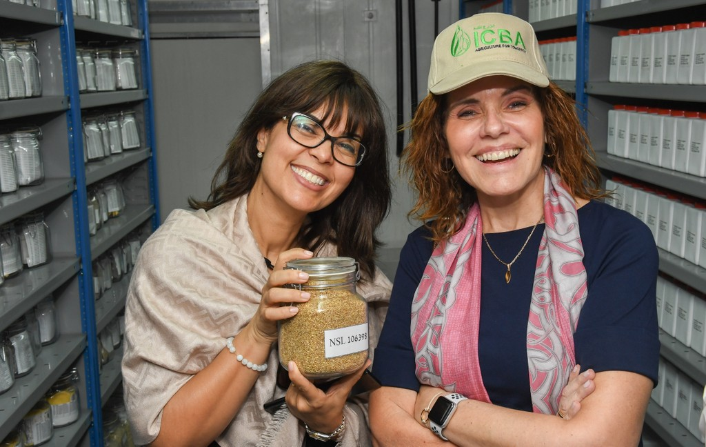 The Food Forever Chair, HE Mercedes Aráoz, and ICBA Director General, Ismahane Elouafi, pose with a glass of quinoa seeds in the ICBA genebank. Photo credit: ICBA